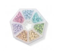 Набор разноцветных люверсов в контейнере Pastel (7 ячеек, 141 люверсов) от We R Memory Keepers